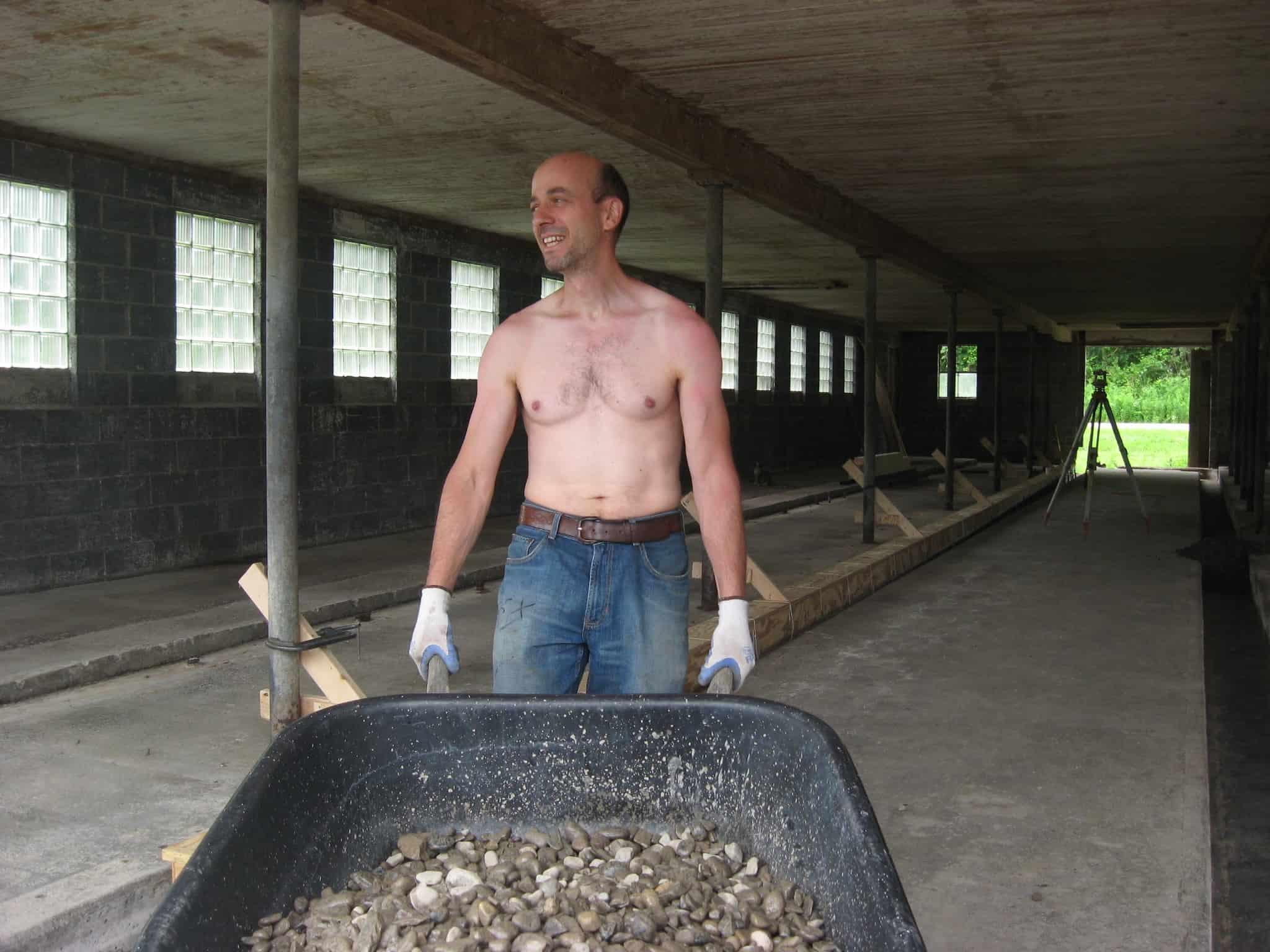 Ezra with wheelbarrow load of gravel.